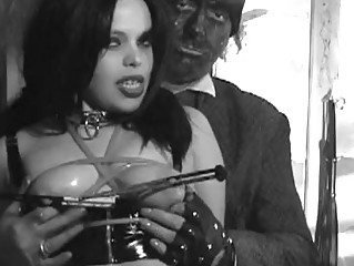Fetish Girl in Dungeon nipple clamps and bound