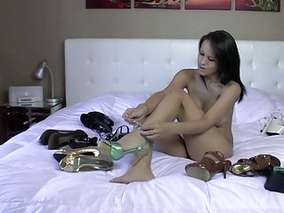 awesome black haired chick tries her high shoes