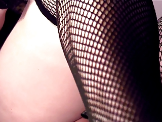 closeup masturbation inside fishnet pantyhose and