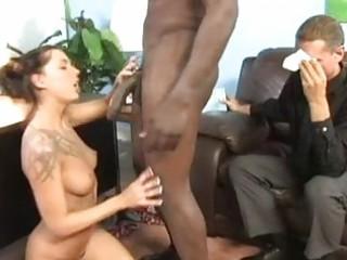 hot brunette with tattooes sucks brown pecker