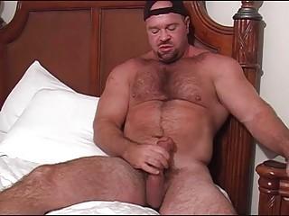 bearded gay bear jerks off his large schlong