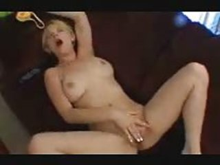 young pushing dildo on armchair