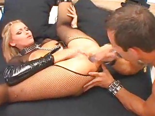 pale woman into latex and fishnets