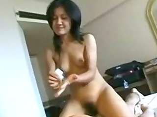thai girl giving massage driving on man on the bed
