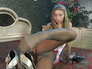 longlegged lady exposes her nyloned foot