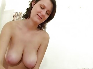 older  chick with giant breast gives a handjob